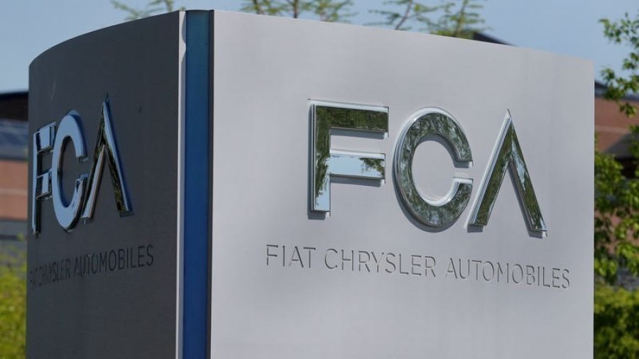 FILE PHOTO: A Fiat Chrysler Automobiles (FCA) sign is at the U.S. headquarters in Auburn Hills, Michigan, U.S. May 25, 2018.  REUTERS/Rebecca Cook/File Photo
